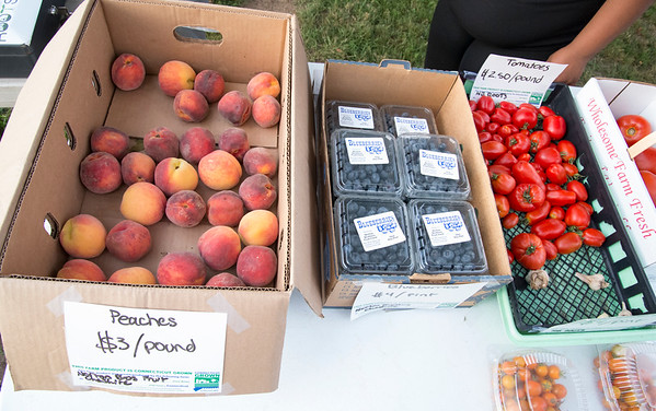 08/05/19 Wesley Bunnell | Staff Fresh fruit and vegetables for sale at the New Britain Roots mobile farmers market truck on Monday evening at Walnut Hill Park.