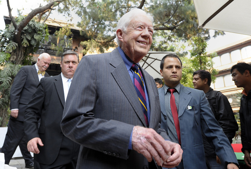 . Former US President Jimmy Carter (C) leaves after a press conference in Kathmandu on April 1, 2013.  Carter is in Kathmandu on a  four-day visit. PRAKASH MATHEMA/AFP/Getty Images