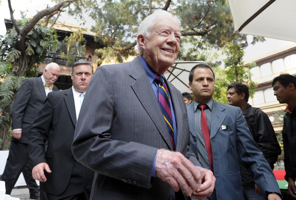 . Former US President Jimmy Carter (C) leaves after a press conference in Kathmandu on April 1, 2013.  Carter is in Kathmandu on a  four-day visit. PRAKASH MATHEMA/AFP/Getty Images