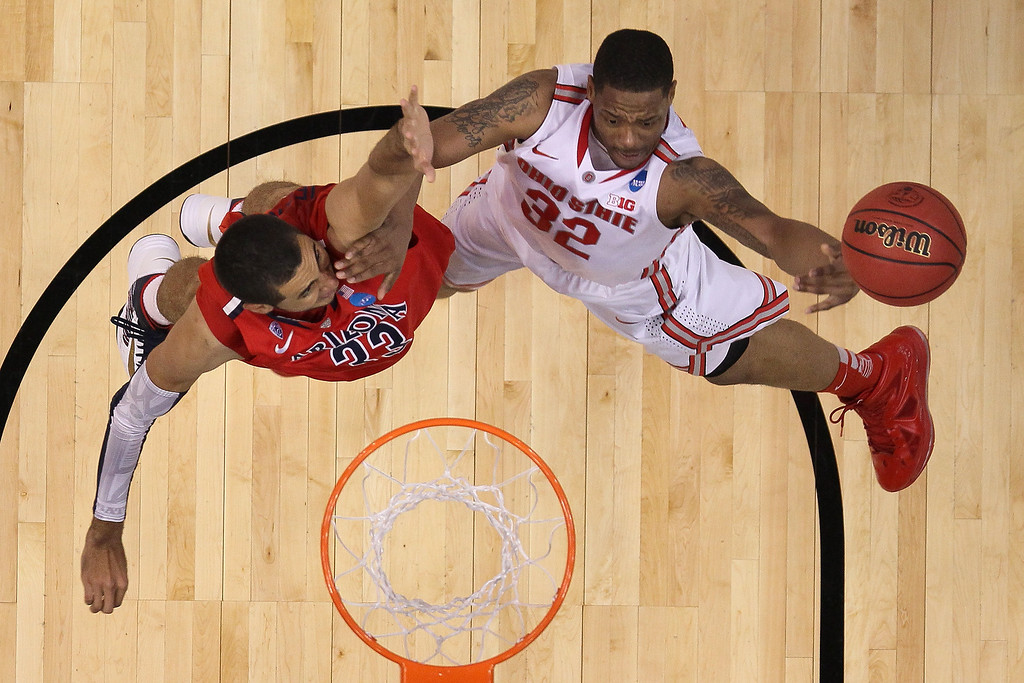 . Lenzelle Smith Jr. #32 of the Ohio State Buckeyes goes up for a shot against Grant Jerrett #33 of the Arizona Wildcats in the second half during the West Regional of the 2013 NCAA Men\'s Basketball Tournament at Staples Center on March 28, 2013 in Los Angeles, California.  (Photo by Jeff Gross/Getty Images)