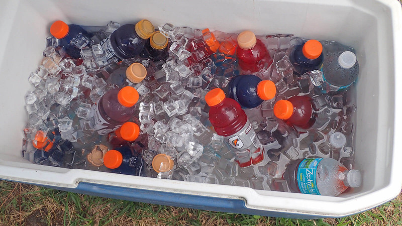 Water and Gatorade in cooler in ice