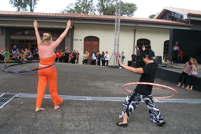 YOGA FESTIVAL - Sept. 11, 2011 - CENAC  Marty Bernard with http://Facebook.com/HoopnosisCostaRica & Maria Hon of Tin Jo Asian Restaurant fame - http://Facebook.com/tinjorestaurant - showing the audience how to do HOOP YOGA (with hula hoops!)