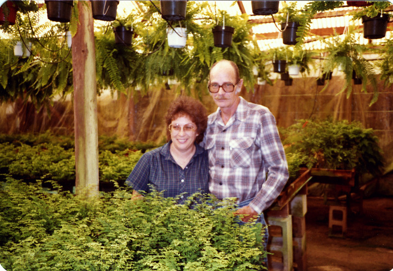 Barbara and Jim Page in their fern greenhouse