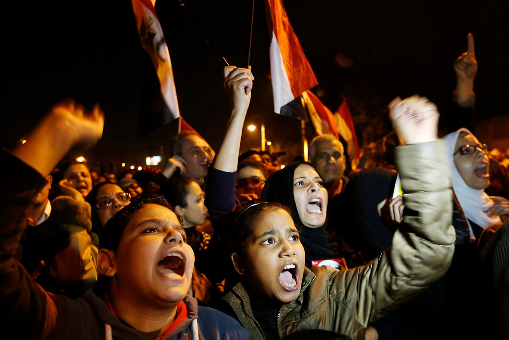 . Protesters chant slogans during a demonstration in front of the presidential palace in Cairo, Egypt, Sunday, Dec. 9, 2012.  Egypt\'s liberal opposition called for more protests Sunday, seeking to keep up the momentum of its street campaign after the president made a partial concession overnight but refused its main demand he rescind a draft constitution going to a referendum on Dec. 15. (AP Photo/Petr David Josek)