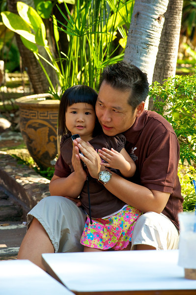 Ninee and dad listening to the morning prayers