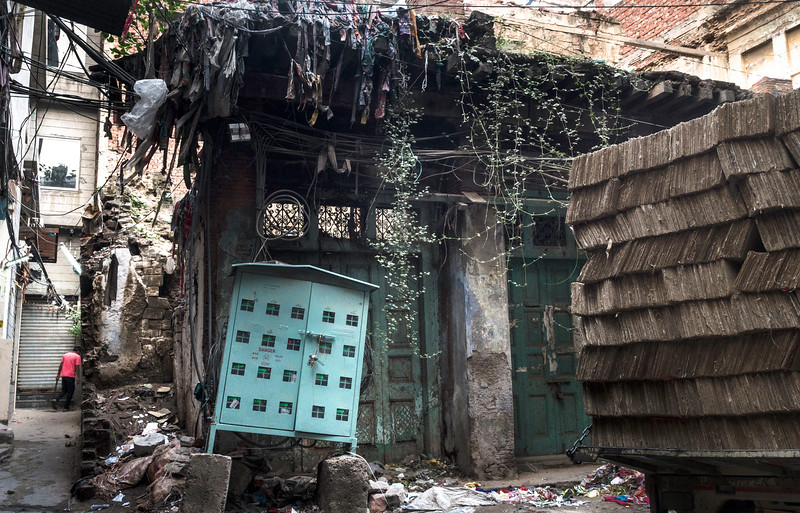 The old dilapidated building instead of being demolished becomes the local garbage dumping site.