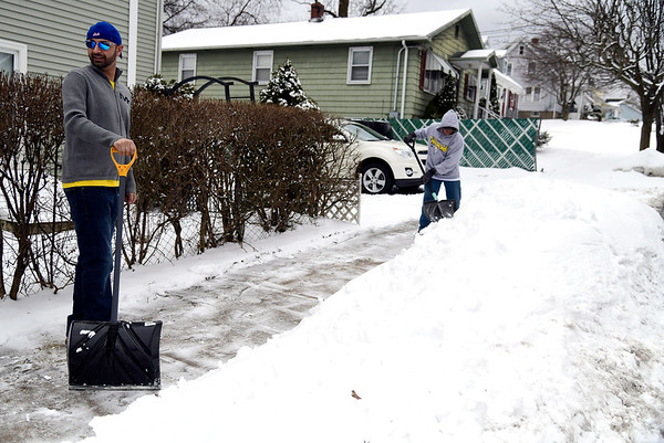 3/2/2019 Mike Orazzi | Staff Andre Nagle and Corey Nagle while shoveling snow on Allen Street in Bristol Saturday.