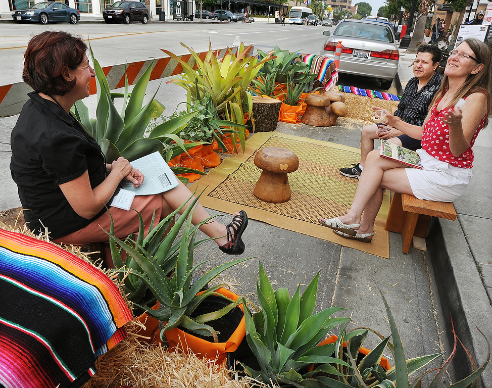 . Blair Miller, left, Wafic, and Sylvia Holmes enjoy conversation during PARKday in front on Colorado Boulevard. On Friday, September 20th on Colorado Boulevard in front of Yahaira\'s Cafe in the  Pasadena�s Playhouse District,celebrated international PARK(ing) Day by transforming two parking spaces into temporary parklets. Pasadena is the first city in San Gabriel Valley to participate in this worldwide grassroots event.(Photo by Walt Mancini/Pasadena Star-News)