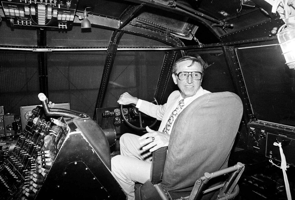 ". Dave Grant, co-pilot for Howard Hughes when the millionaire took his massive flying boat known as the ""Spruce Goose\"" aloft for its only flight on Nov. 2, 1947, sits in his old seat in the craft\'s cockpit on July 28, 1980, in Long Beach, Calif. Grant was a hydraulic engineer who did not have a pilot\'s license when serving as Hughes\' co-pilot. (AP Photo/ Rasmussen)"