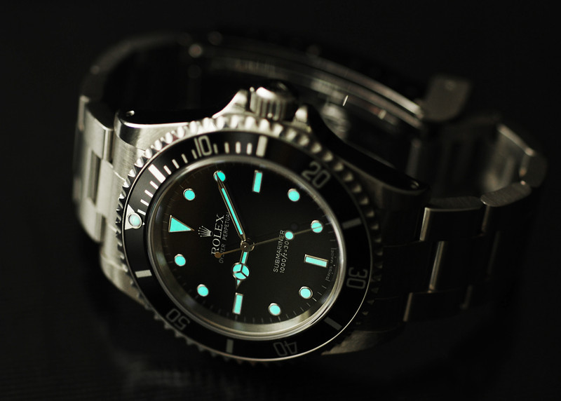 Rolex diver's watch, Oyster Perpetual Submariner reference 14060M model. Loved photographing and seeing this watch in photographs, but seldom actually wore it.  Photographed using Nikon D80 digital camera with AF Micro-Nikkor 60mm f/2.8D lens: APS-C sensor (23.6mm x 15.8mm), 10.2 megapixels; set to f/3.3 at 1/4-second exposure, ISO 200; hot light and available light (dial luminescence). Composed within 7 x 5 aspect; jpeg. Processed in Adobe Photoshop Elements 10.  Select subject matter: Leo's Jewelers, Wayne, Michigan  April 28, 2008
