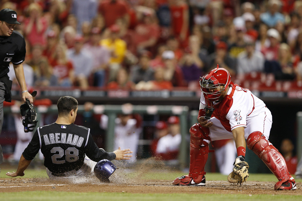 . CINCINNATI, OH - MAY 9: Nolan Arenado #28 of the Colorado Rockies slides at home plate to score the tying run after a double by Justin Morneau in the top of the ninth inning of the game against the Cincinnati Reds at Great American Ball Park on May 9, 2014 in Cincinnati, Ohio. The Reds won 4-3. (Photo by Joe Robbins/Getty Images)