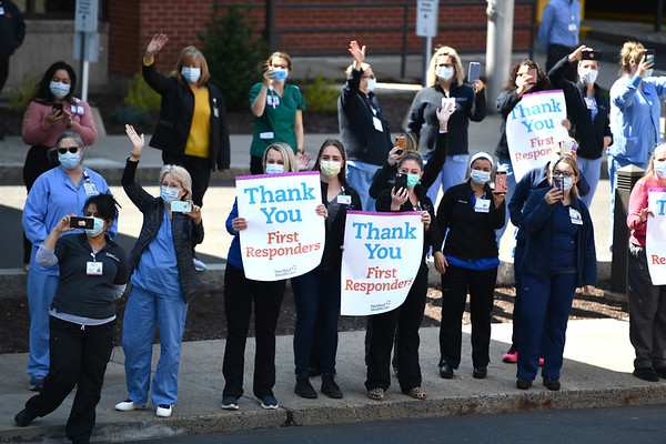 4/17/2020 Mike Orazzi | StaffrThe mutual salute in front of The Hospital of Central Connecticut in New Britain as a way to acknowledge the hard work and dedication of both medical staff and local first responders during the COVID-19 pandemic.