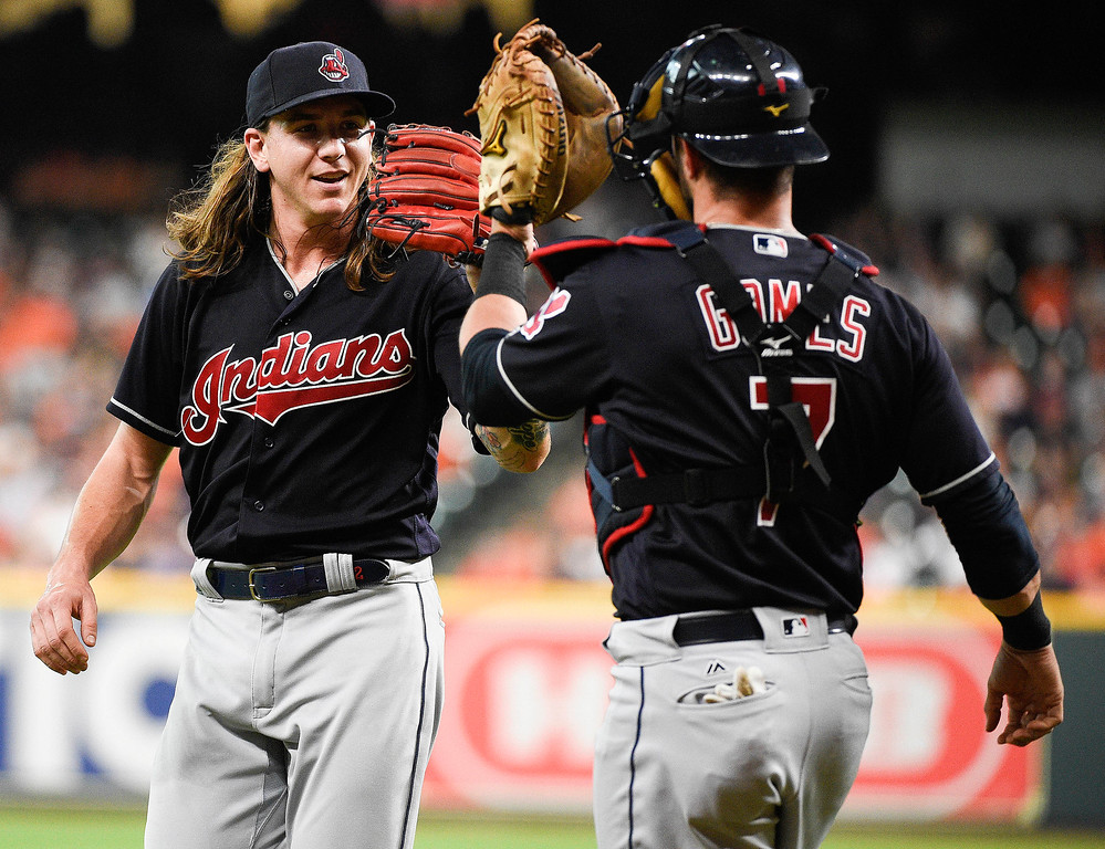 . Cleveland Indians starting pitcher Mike Clevinger, left, and catcher Yan Gomes celebrate after a double play to end the first inning of a baseball game against the Houston Astros, Friday, May 18, 2018, in Houston. (AP Photo/Eric Christian Smith)