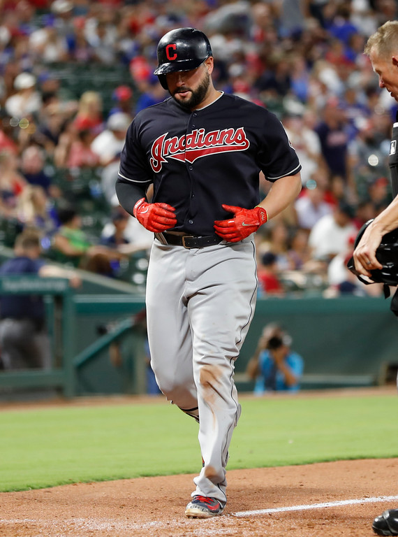. Cleveland Indians\' Yonder Alonso arrives home on his solo home run against the Texas Rangers during the seventh inning of a baseball game, Saturday, July 21, 2018, in Arlington, Texas. (AP Photo/Jim Cowsert)