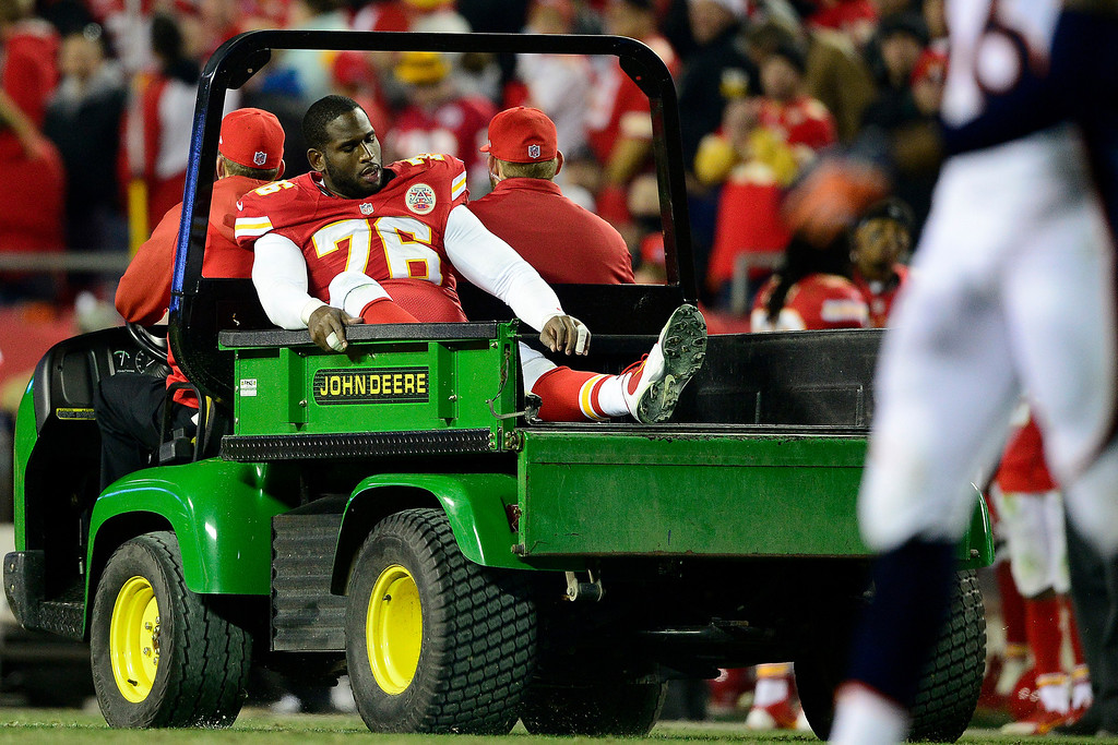 . Branden Albert (76) of the Kansas City Chiefs is carted off the field during the second half of the Broncos\' 35-28 win at Arrowhead Stadium.   (Photo by AAron Ontiveroz/The Denver Post)
