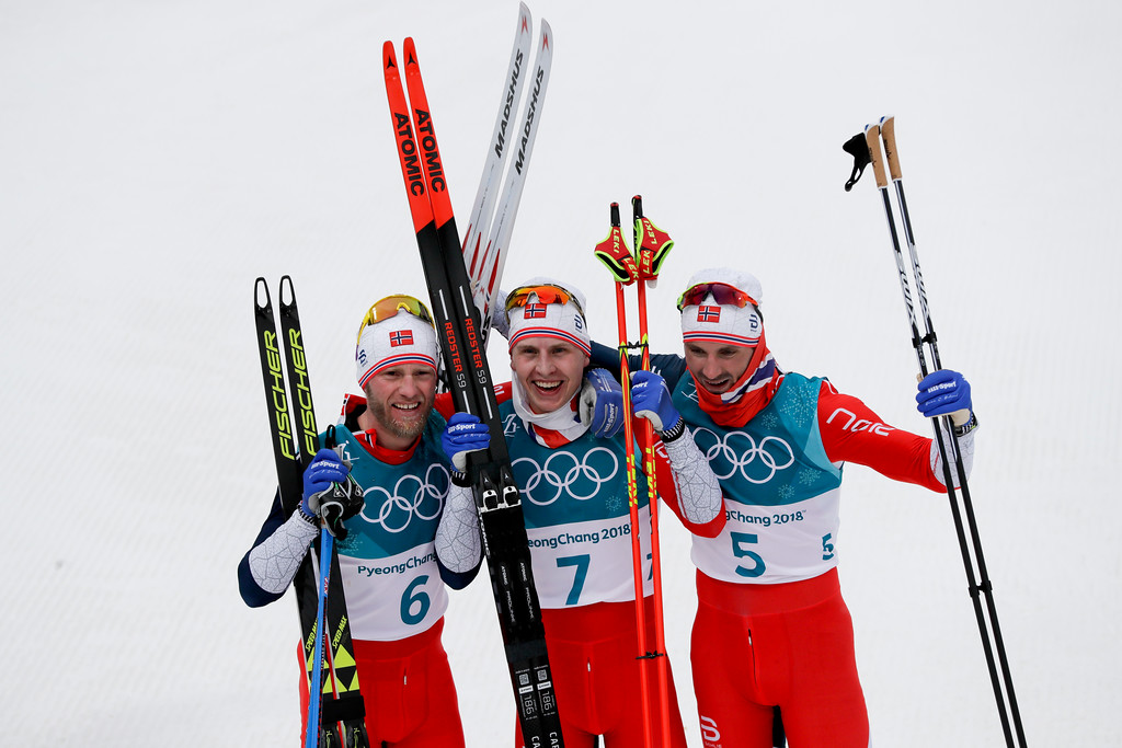 . Gold medal winner Simen Hegstad Krueger, of Norway, is flanked by silver medal winner Martin Johnsrud Sundby, of Norway, left, and bronze medal winner Hans Christer Holund, of Norway, after the men\'s 15km/15km skiathlon cross-country skiing competition at the 2018 Winter Olympics in Pyeongchang, South Korea, Sunday, Feb. 11, 2018. (AP Photo/Kirsty Wigglesworth)