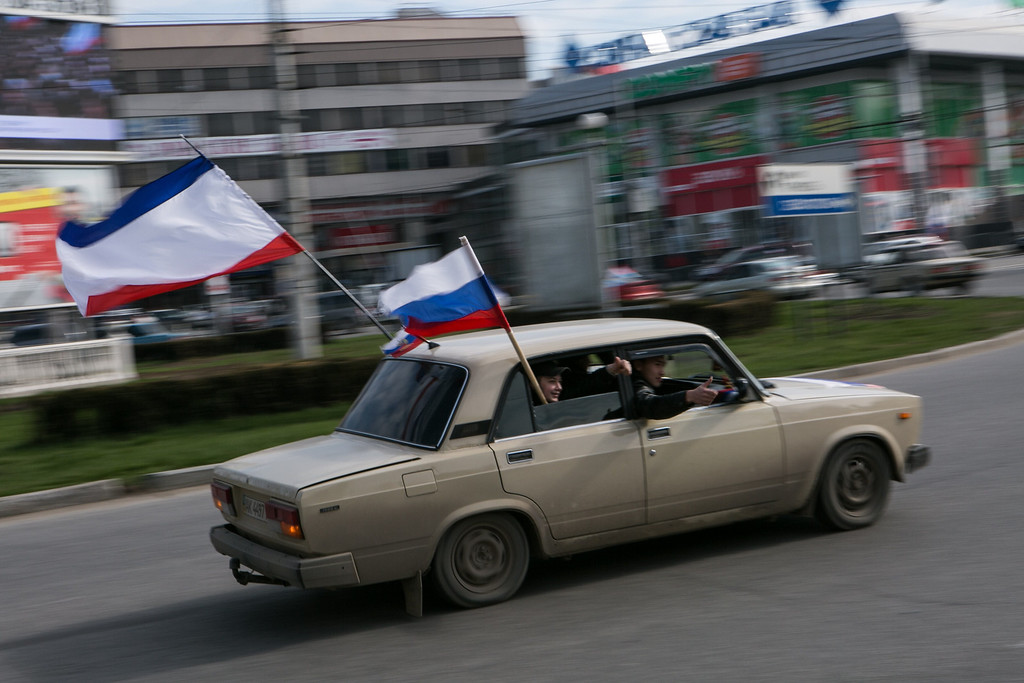. Pro-russian supporters drive in the centre of Simferopol, on March 14, 2014, as they honk and fly Russian flags two days ahead of the referendum over Crimea bid to break away from Ukraine and join Russia. US Secretary of State John Kerry met Russian Foreign Minister Sergei Lavrov in London on March 14 with few hopes that Sunday\'s Moscow-backed referendum in the strategic Black Sea peninsula could be averted or delayed.  DANIEL LEAL OLIVAS/AFP/Getty Images