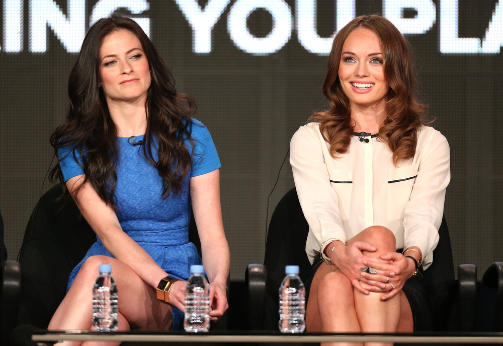 Description of . Actresses Lara Pulver (L) and Laura Haddock speak onstage at the