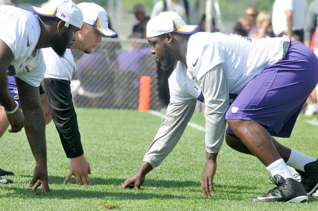 . Vikings defensive tackles Shariff Floyd, left, and Chase Baker face off against guard Travis Brown while working on scrimage line technique.   (Pioneer Press: John Doman)