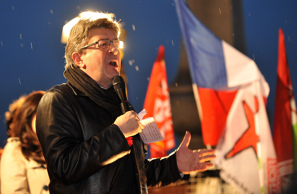 """. French far-left Parti de Gauche (PG) party leader, Jean-Luc Melenchon delivers a speech on March 6, 2013 near the Alexandre III bridge in Paris, as he takes part in a rally in tribute to Venezuelian President Hugo Chavez who died from cancer at 58, on March 5. \""""What he is never dies\"""", wrote Melenchon in a tweet last night. Melenchon paid several visits to Venezuela during Chavez\' presidency.   AFP PHOTO / PIERRE  ANDRIEU/AFP/Getty Images"""