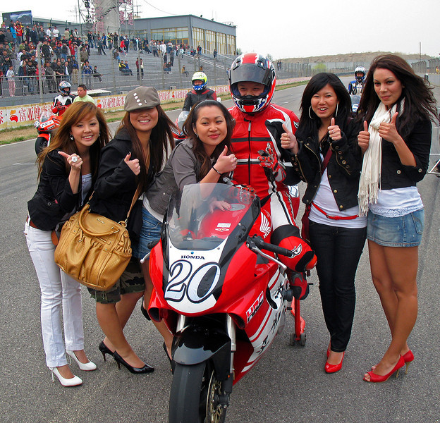 Motorcycle race with Fans, Beijing Goldenport Track 2007 © Lewis Sandler Beijing Video Studio