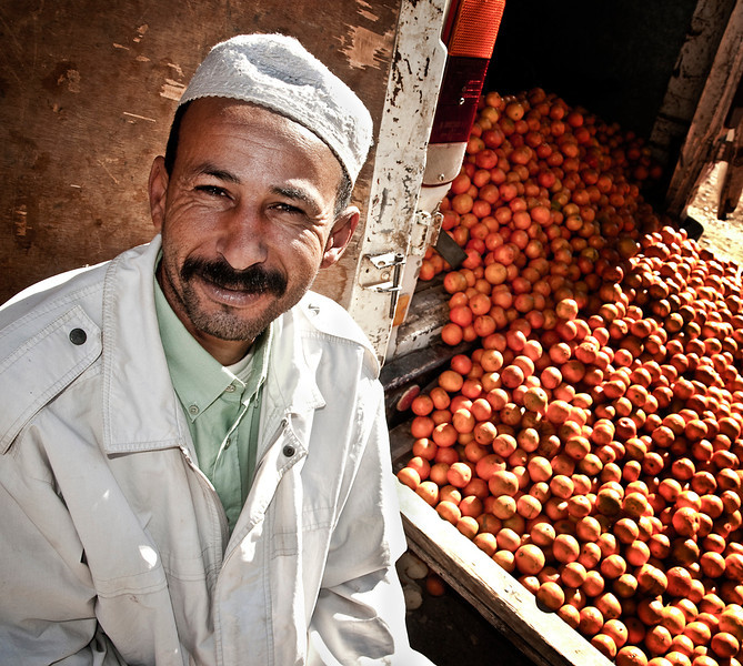 Morocco is a major exporter of oranges. Fresh orange juice can be readily found around the country. this salesman sells his oranges from a truck parked outside the local fruit market.  Agdz, Morocco, 2010.