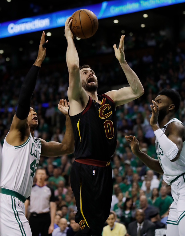 . Cleveland Cavaliers center Kevin Love (0) goes up for a shot between Boston Celtics forward Al Horford, left, and guard Jaylen Brown during the first quarter of Game 5 of the NBA basketball Eastern Conference finals Wednesday, May 23, 2018, in Boston. (AP Photo/Charles Krupa)