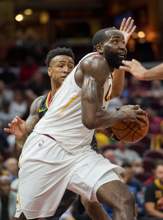 . Cleveland Cavaliers\' Kendrick Perkins drives past Atlanta Hawks\' John Collins during the second half of an NBA preseason basketball game in Cleveland, Wednesday, Oct. 4, 2017. The Hawks won 109-93. (AP Photo/Phil Long)