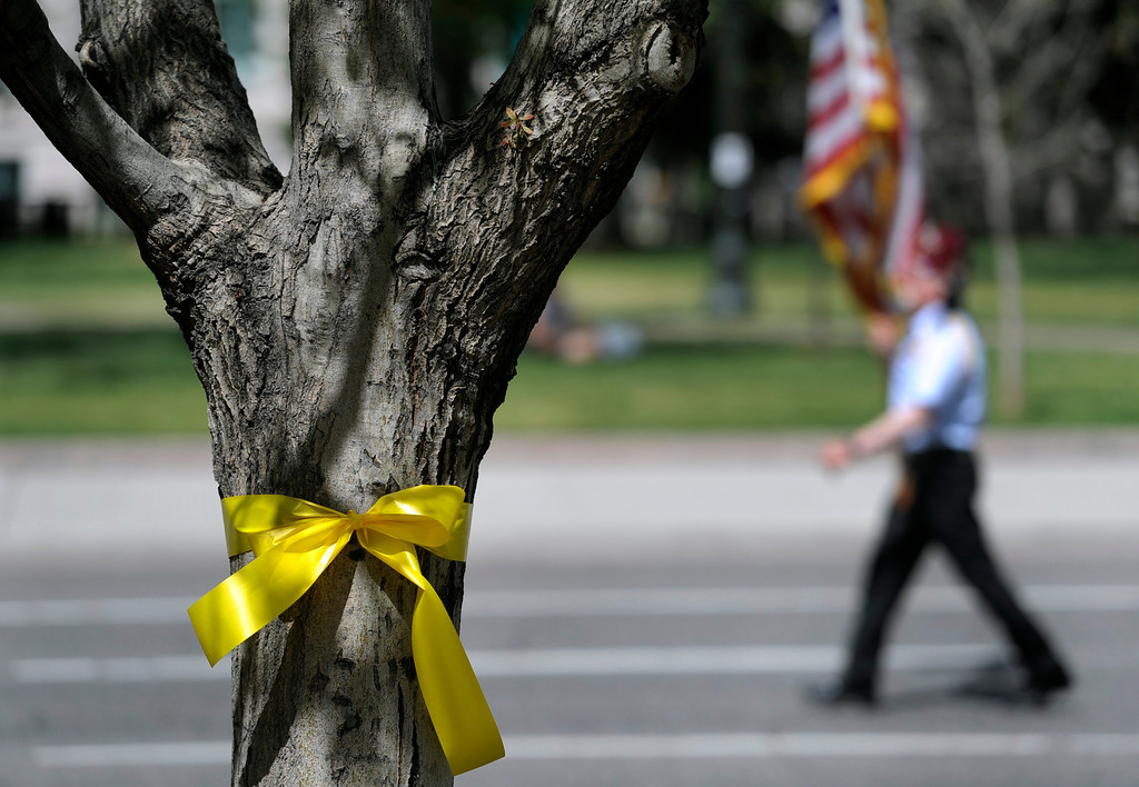 . Yellow ribbons were tied to many of the trees along Broadway. (Photo By Kathryn Scott Osler/The Denver Post)