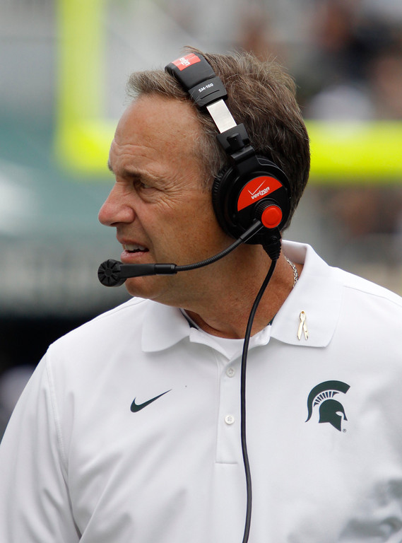 . Michigan State coach Mark Dantonio watches the action during the fourth quarter of an NCAA college football game against Eastern Michigan, Saturday, Sept. 20, 2014, in East Lansing, Mich. Michigan State won 73-14. (AP Photo/Al Goldis)