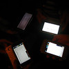 phones on a table: the l33t edition with communicators and nokia n810's