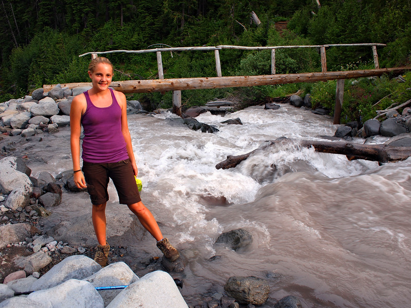 Emily at our bridge, after several hours of struggling along thr river downstream, through rocks and nearly impenetrable underbrush. We still have a couple miles to hike back up switchbacks to Summerland.
