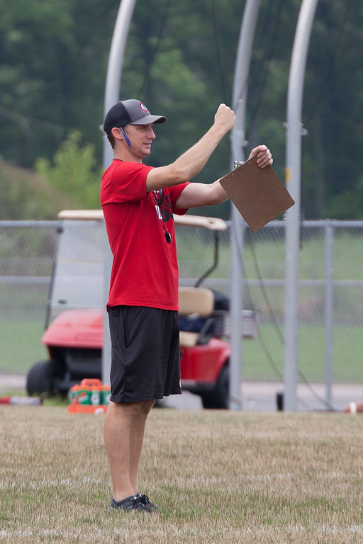 . Jen Forbus - The Morning Journal<br> Brookside coach Paul Ferguson gives the defense signals during Brookside\'s first day of football practice on July 30.