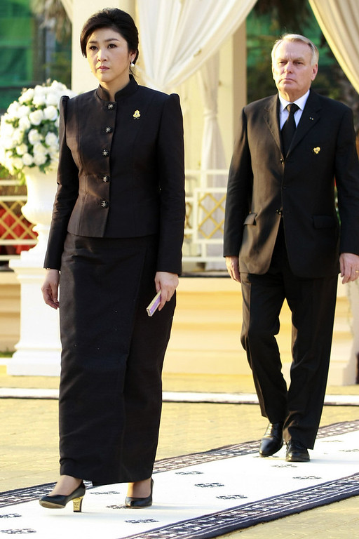 . Thai Prime Minister Yingluck Shinawatra (L) and France Prime Minister Jean-Marc Ayrault (R) walk  during a cremation ceremony for the late former King Norodom Sihanouk, near the Royal Palace in Phnom Penh on February 4, 2013. Thousands of mourners massed in the Cambodian capital as the kingdom cremated its revered former King Norodom Sihanouk, who steered his country through six turbulent decades. AFP PHOTO/ KHEM SOVANNARA/AFP/Getty Images
