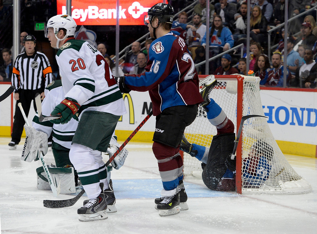 . DENVER, CO - APRIL 26: Colorado Avalanche center Nathan MacKinnon (29) goes down in the Minnesota Wild net during the second period of action. The Colorado Avalanche hosted the Minnesota Wild in the fifth round of the Stanley Cup Playoffs at the Pepsi Center in Denver, Colorado on Saturday, April 26, 2014. (Photo by John Leyba/The Denver Post)
