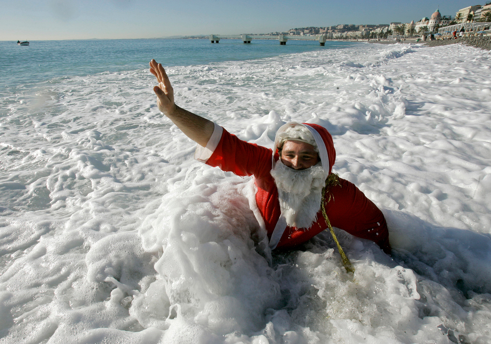 Description of . A man dressed up as Santa Claus is seen during the 64th pre-Christmas swim in Nice, southern France, Sunday, Dec. 21, 2008. (AP Photo/Lionel Cironneau)