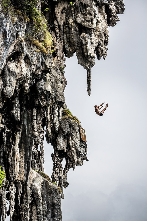 . In this handout image provided by Red Bull, Andy Jones of the USA dives from a 25 meter rock at Viking Caves in the Andaman Sea during competition on the fifth day of the final stop of the 2013 Red Bull Cliff Diving World Series on October 24, 2013 at Phi Phi Island, Thailand. (Photo by Romina Amato/Red Bull via Getty Images)
