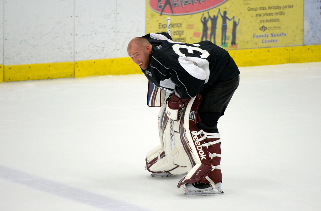 . Colorado Avalanche G J.S. Giguere (35) skates to the bench for a water break during practice September 9, 2013 at Family Sports. (Photo By John Leyba/The Denver Post)