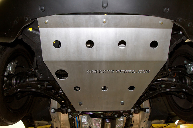 Viewed from below, the three bolts in the front and the two in the rear are in place.  The large hole on the left provides clearance access to the crankcase drain plug.