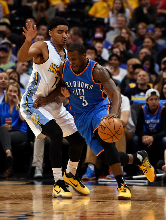 . Oklahoma City Thunder guard Dion Waiters (3) drives around Denver Nuggets guard Gary Harris (14) during the first quarter April 5, 2016 at Pepsi Center. (Photo By John Leyba/The Denver Post)