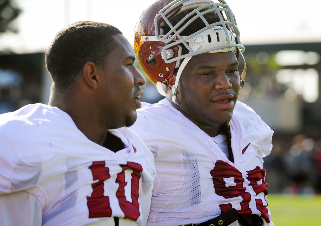 . USC linebacker Hayes Pullard talks with DL Antwaun Woods at practice, Thursday, March 27, 2014, at USC. (Photo by Michael Owen Baker/L.A. Daily News)