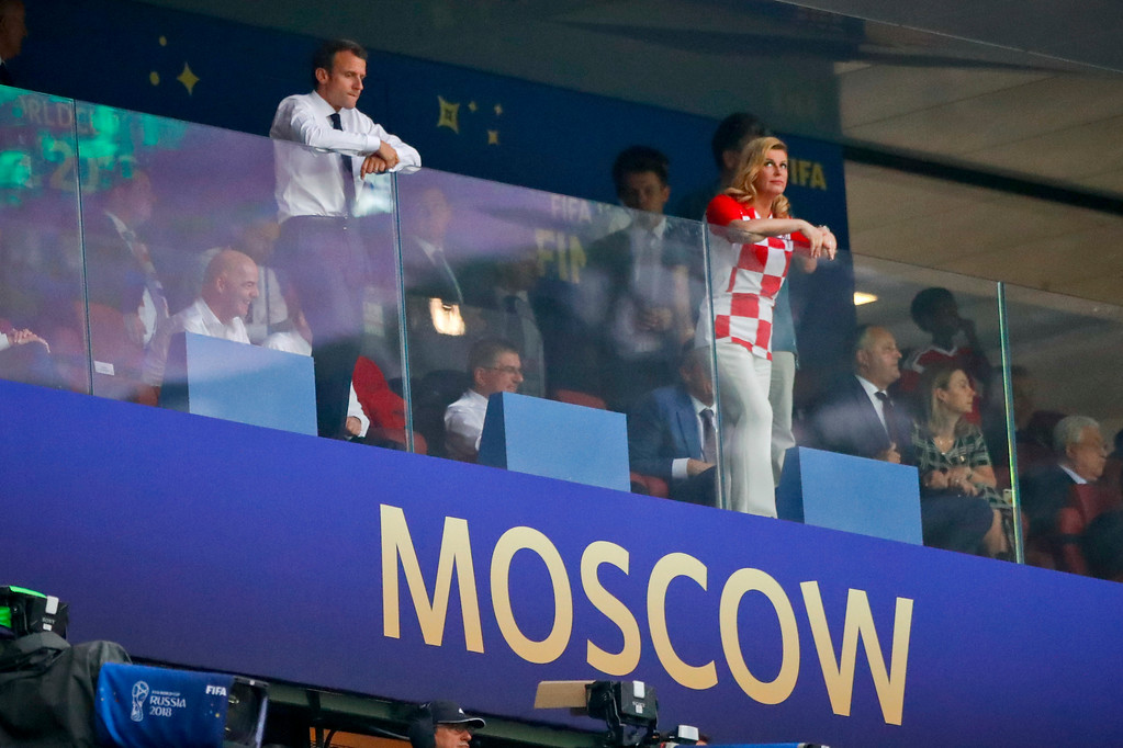 . French President Emannuel Macron, left, and Croatian President Kolinda Grabar-Kitarovic watch the final match between France and Croatia at the 2018 soccer World Cup in the Luzhniki Stadium in Moscow, Russia, Sunday, July 15, 2018. (AP Photo/Matthias Schrader)