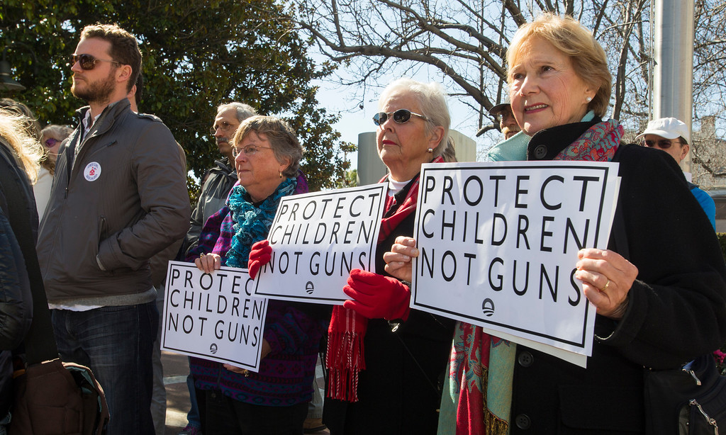 . Palo Alto residents, from left, Marianne Moutoux, Carol Kenyon and Marilee Anderson, attend the Silicon Valley Community Against Gun Violence  rally. (John Green/Staff)