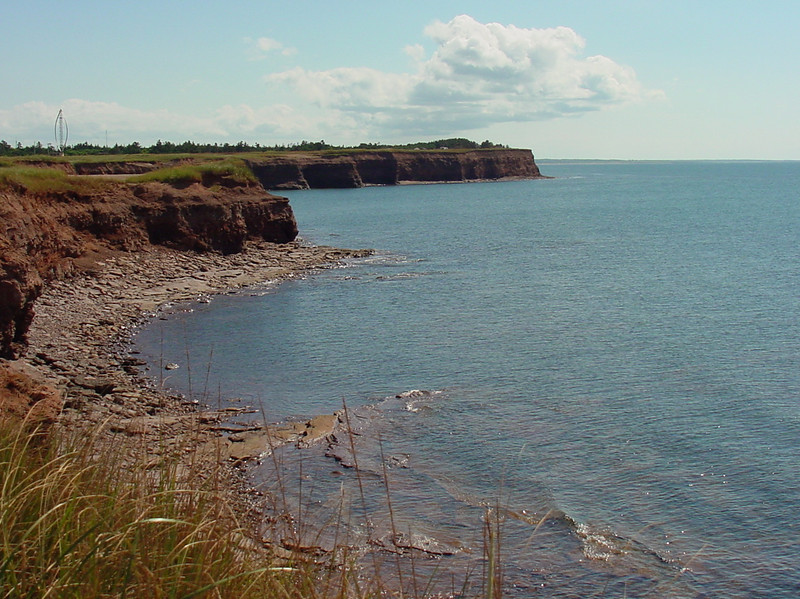 """A Shoreline view of Prince Edward Island. Red soil make for perfect potatos and the Island abounds with character and entertainment. The Capital, Charlottetown is the birthplace of the Canadian Nation, where the Fathers of Cconfederation met to build a country. The City of Charlottetown is a flourishing community of over 32,000 people located on the south shore of Prince Edward Island. Charlottetown is the capital city of Prince Edward Island, and is called the """"Birthplace of Confederation"""" after the historic 1864 Charlottetown Conference which led to Confederation"""
