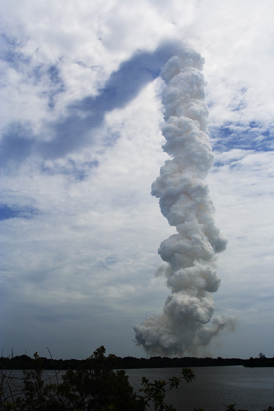The launch plume and shadow.