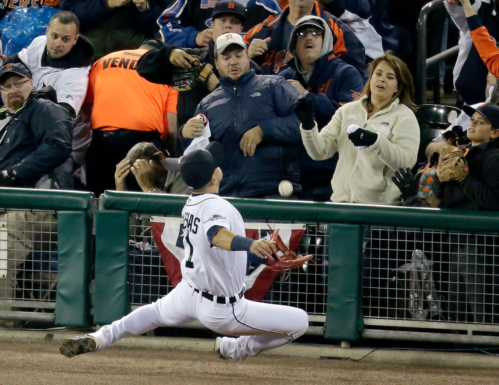. Detroit Tigers shortstop Jose Iglesias tries to make a play on a ball hit by Boston Red Sox\'s Mike Carp in the sixth inning during Game 4 of the American League baseball championship series Wednesday, Oct. 16, 2013, in Detroit. (AP Photo/Charlie Riedel)