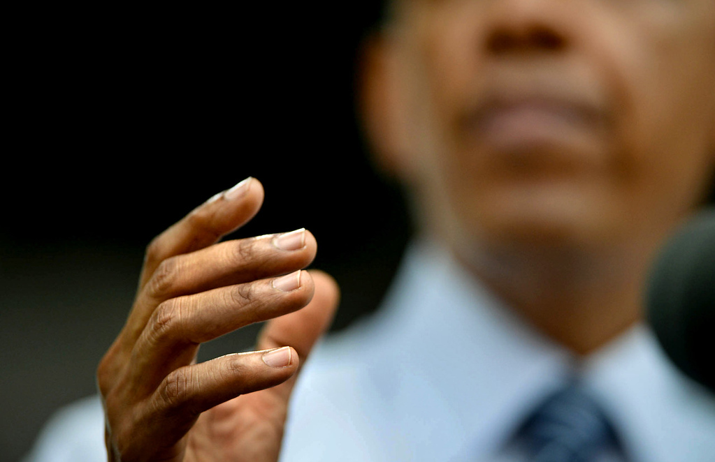 . President Barack Obama emphasizes remarks concerning local and national economic issues at the Lake Harriet Bandshell in Minneapolis on Friday, June 27, 2014. (Pioneer Press: Ben Garvin)