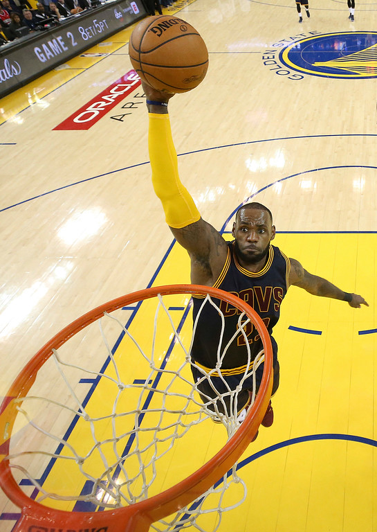 . Cleveland Cavaliers forward LeBron James (23) dunks against the Golden State Warriors during the second half of Game 1 of basketball\'s NBA Finals in Oakland, Calif., Thursday, June 1, 2017. (Ezra Shaw/Pool Photo via AP)