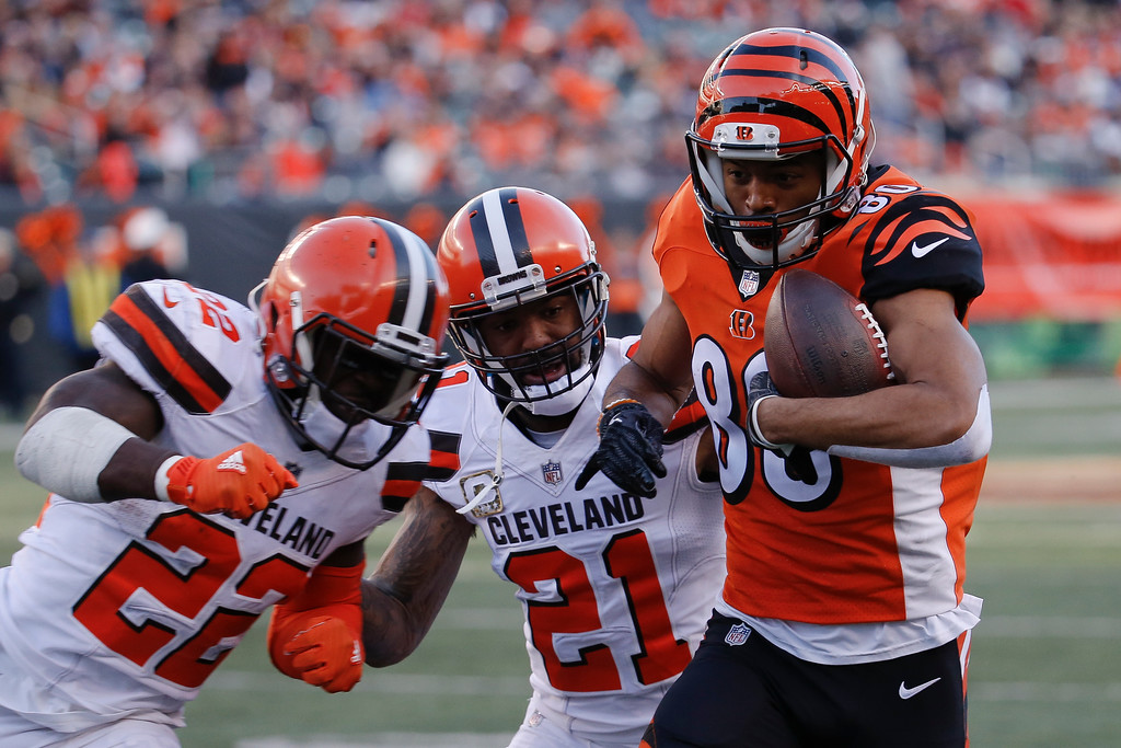 . Cincinnati Bengals wide receiver Josh Malone (80) runs the ball against Cleveland Browns free safety Jabrill Peppers (22) in the second half of an NFL football game, Sunday, Nov. 26, 2017, in Cincinnati. (AP Photo/Frank Victores)