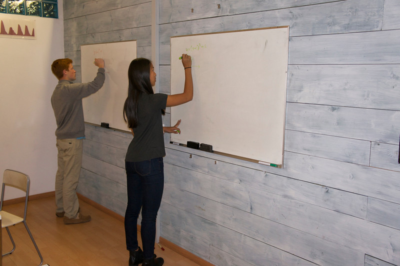 Math Class—Charlie and Lucy working on the board to solve a problem